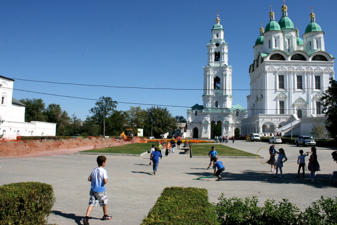 Children playing next to the Cathedral and the Bell Tower